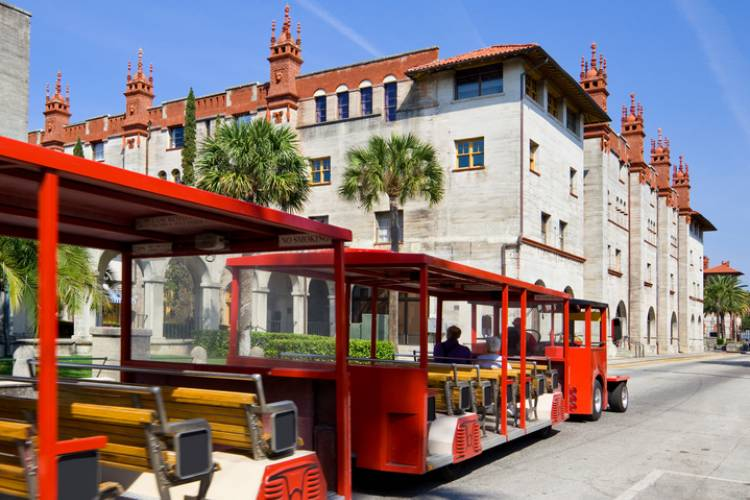 A tram drives past the Lightner Museum in St. Augustine